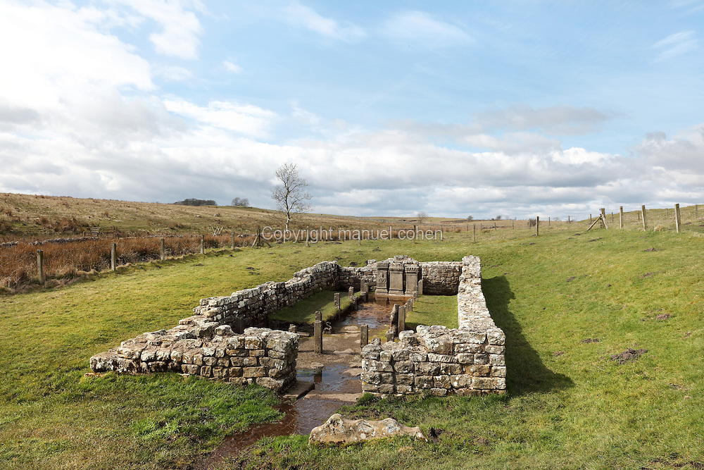 Temple of Mithras, built c. 200 AD by soldiers based at the nearby Carrawburgh Roman Fort, on Hadrian's Wall, Northumberland, England. The temple is dedicated to the god Mithras, who captured and killed a bull in a cave, the 1st creature created on earth, and all other creatures sprang to life from his blood. Mithraic temples are small and confined to represent the cave. The 3 altars are all dedicated by commanding officers of the unit stationed here, the First Cohort of Batavians from the Rhineland. In 1 of the altars a series of pierced holes form Mithras' crown, through which a lamp would have been shone at a high point of the ritual. A curtain would have been drawn back, allowing sunlight to stream in, illuminating the backdrop of Mithras slaying the bull, the triumph of light over darkness. Hadrian's Wall was built 73 miles across Britannia, now England, 122-128 AD, under the reign of Emperor Hadrian, ruled 117-138, to mark the Northern extent of the Roman Empire and guard against barbarian attacks from the Picts to the North. The wall was fortified with milecastles with 2 turrets in between, and a fort about every 5 Roman miles. This section of the Wall is in the Northumberland National Park, managed by English Heritage, and the Hadrian's Wall Path, an 84-mile coast to coast long distance footpath, runs alongside it. Picture by Manuel Cohen