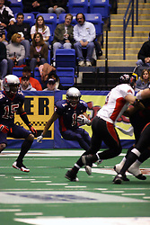 14 April 2007: Reggie Gray looks for some space behind blockerDion Brown. during a United Indoor Football League game that pitted the RiverCity Rage who won 29-11 against the Bloomington Extreme at the U.S. Cellular Coliseum in Bloomington Illinois..