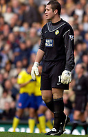 Photo. Jed Wee.<br /> Leeds United v Arsenal, FA Barclaycard Premiership, Elland Road, Leeds. 01/11/03.<br /> A shell shocked Leeds goalkeeper Paul Robinson looks on after Arsenal score their second and celebrate in the background.