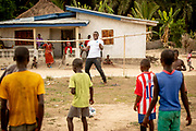 Unicef high profile supporter David Harewood plays football with residents of Komrabai Village during his trip to Sierra Leone.