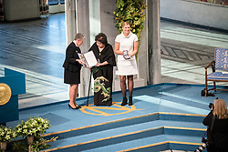 """10 December 2017, Oslo, Norway: Oslo City Hall hosts the Nobel Peace Prize award ceremony on 9-10 December 2017. The prize in 2017 goes to the International Campaign to Abolish Nuclear Weapons (ICAN), for """"its work to draw attention to the catastrophic humanitarian consequences of any use of nuclear weapons and for its ground-breaking efforts to achieve a treaty-based prohibition of such weapons"""". Here, ICAN representatives Beatrice Fihn (right) and Setsuko Thurlow (left) receive their medal and diploma."""