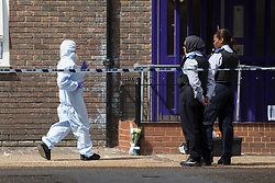 © licensed to London News Pictures. London, UK 13/08/2013. Police and forensic officers investigating Spey Street in Poplar, east London where 16-year-old Ajmol Alom was found stabbed. Photo credit: Tolga Akmen/LNP