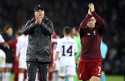 Liverpool manager Jurgen Klopp (left) and James Milner applaud the fans at the end of the match