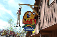 The proprietor of a gold mining store in gold rush town, Jamestown, California, USA, has a rather macabre way of attracting attention to his business - a claim-jumper hanging from a gallows at the front of his premises. April 2013. 201304201608<br /> <br /> Copyright Image from Victor Patterson, 54 Dorchester Park, Belfast, UK, BT9 6RJ<br /> <br /> Tel: +44 28 9066 1296<br /> Mob: +44 7802 353836<br /> Voicemail +44 20 8816 7153<br /> Skype: victorpattersonbelfast<br /> Email: victorpatterson@me.com<br /> Email: victorpatterson@ireland.com (back-up)<br /> <br /> IMPORTANT: If you wish to use this image or any other of my images please go to www.victorpatterson.com and click on the Terms & Conditions. Then contact me by email or phone with the reference number(s) of the image(s) concerned.