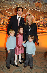 CROWN PRINCE PAVLOS and PRINCESS MARIE CHANTAL OF GREECE with their children, left to right, PRINCE CONSTANTINE, PRINCESS OLYMPIA and PRINCE ACHILEAS at a children's party in aid of the charity Over The Wall held at Fortnum & Mason, Piccadilly, London before a gala premiere of the new musical Mary Poppins at The Prince of Wales Theatre, Old Compton Street, London W1<br />