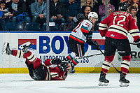 KELOWNA, BC - FEBRUARY 15: Christoffer Sedoff #4 of the Red Deer Rebels falls to the ice after a check by Dillon Hamaliuk #22 of the Kelowna Rockets at Prospera Place on February 15, 2020 in Kelowna, Canada. (Photo by Marissa Baecker/Shoot the Breeze)