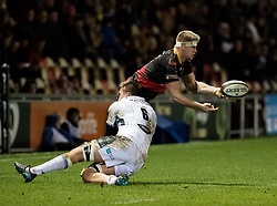 Dragons' Aaron Wainwright is tackled by Glasgow Warriors' Matt Fagerson<br /> <br /> Photographer Simon King/Replay Images<br /> <br /> Guinness PRO14 Round 14 - Dragons v Glasgow Warriors - Friday 9th February 2018 - Rodney Parade - Newport<br /> <br /> World Copyright © Replay Images . All rights reserved. info@replayimages.co.uk - http://replayimages.co.uk