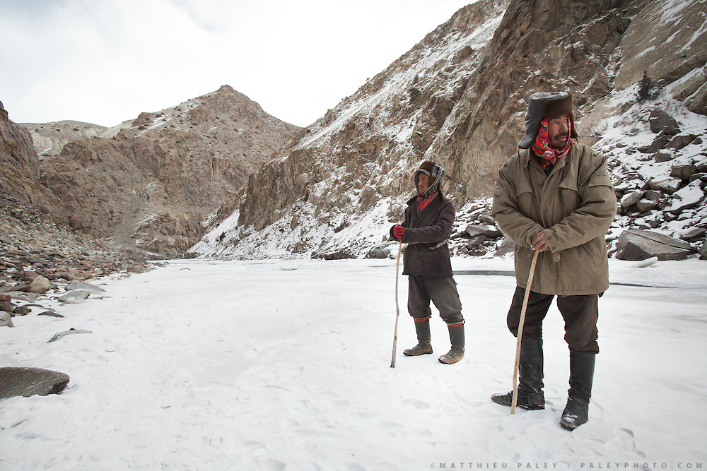 Kyrgyz man named Ganji Boi (left) and a family relative, coming down to Sarhad to barter their yaks..Discussing the difficulties on the way to Pamir...Trekking up the Wakhan frozen river, the only way up to reach the high altitude Little Pamir plateau, home of the Afghan Kyrgyz community.