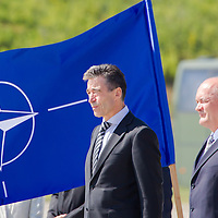 Anders Fogh Rasmussen (L) secretary general of NATO and Csaba Hende (R) Defence minister of Hungary open a new hangar construction area of the Strategic Airlift Capability (SAC) programme in Papa (about 165 km west of Budapest), Hungary on July 01, 2013. ATTILA VOLGYI