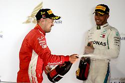 April 8, 2018 - Sakhir, Bahrain - Motorsports: FIA Formula One World Championship 2018, Grand Prix of Bahrain, , #5 Sebastian Vettel (GER, Scuderia Ferrari)#44 Lewis Hamilton (GBR, Mercedes AMG Petronas F1 Team) (Credit Image: © Hoch Zwei via ZUMA Wire)