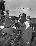 10/05/1962<br /> 05/10/1962<br /> 10 May 1965<br /> Opening of Smiths Motor Group Garage Athy, Co. Kildare. Picture shows the Minister for Agriculture, Mr. Patrick Smith, (left) at the controls of a combine harvester during his tour of the garage after he had officially declared it opened; also in the picture are Mr. C.A. Smith,  Chairman of the Smith Motor Group; Mr John Beatly (bottom) Chief Inspector, Dept. of Agriculture.