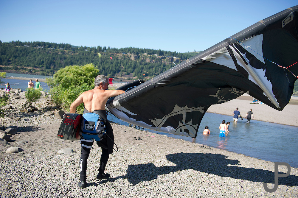Alfonso Jiminez walks out to the kiteboarding area in Hood River, Oregon