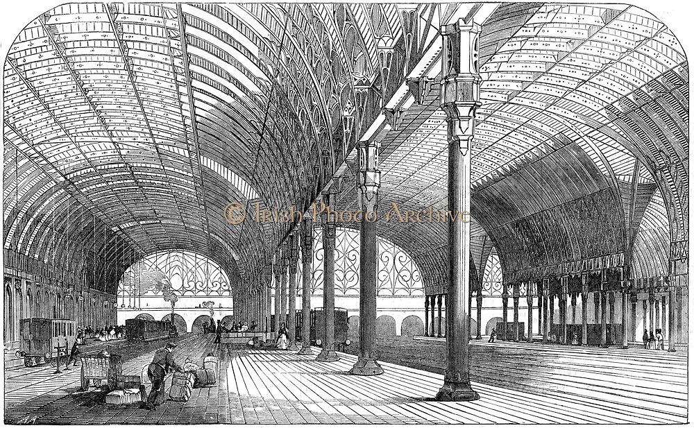 Paddington Station, the London terminus of the Great Western Railway, 1854.  Iron was used in the construction of the roof, and the spans supported on cast iron pillars.  The building was the joint work of Isambard Kingdom Brunel (1806-1859) and Matthew Digby Wyatt (1820-1877). From 'The Illustrated London News', (London, 8 July 1854). Wood engraving.