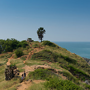 Tourists hiking the trail on Promthep cape, Phuket, Thailand