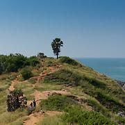 Tourists hiking the trail on Promthep cape, Phuket, Thailand