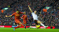 09.11.2013, Anfield, Liverpool, ENG, Premier League, FC Liverpool vs FC Fulham, 11. Runde, im Bild Liverpool's Luis Suarez scores the fourth goal against Fulham, his hat-trick third goal, // during the English Premier League 11th round match between Liverpool FC and Fulham FC at Anfield in Liverpool, Great Britain on 2013/11/09. EXPA Pictures © 2013, PhotoCredit: EXPA/ Propagandaphoto/ David Rawcliffe<br /> <br /> *****ATTENTION - OUT of ENG, GBR*****