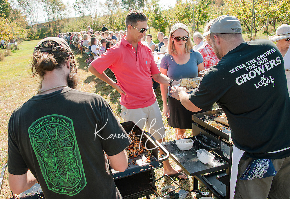 """Local Eatery Chef Kevin Halligan serves Bill Bald and Paula Hiuser ham, cheddar and apple omelets during the """"Breakfast at the Orchard"""" buffet held in Smith's Apple Orchard in Belmont on Sunday morning.  (Karen Bobotas/for the Laconia Daily Sun)"""