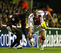 Photo: Chris Ratcliffe.<br />Arsenal v Ajax. UEFA Champions League. 07/12/2005.<br />Quincy Owusu-Abeyie of Arsenal tussles with Tomas Galasek of Ajax