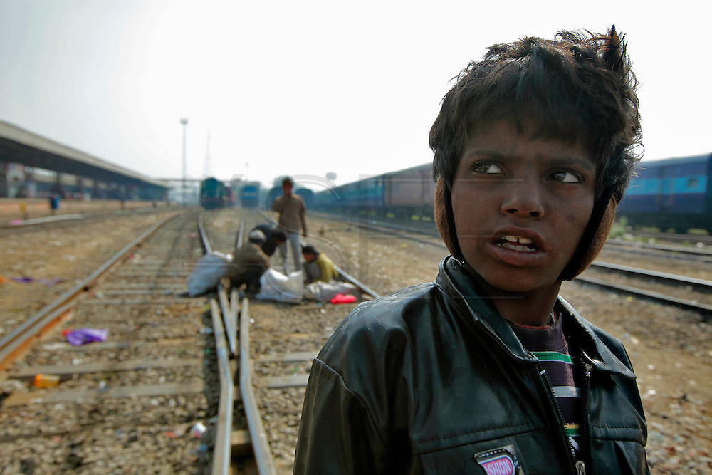 Badal is only 8 years old and is already addicted to glue and living homeless on the tracks in Jaipur, India.  Children, some who have run away from their families, find themselves living homeless on the train tracks waititng for the next train to arrive at the train station in Jaipur, India.  Once the train arrives they raid the train looking for plastic bottles that they can then sell.  Most will make about $1.50/day but spend most of it on glue which they are most addicted to.