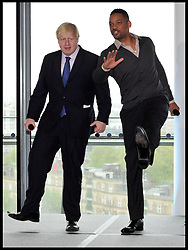 May 24, 2013 - London, England, United Kingdom - Actor WILL SMITH and London Mayor BORIS JOHNSON introduce a presentation for young Londoners involved in the Mayor's Leadership Clubs at City Hall on Friday.  (Credit Image: © Andrew Parsons/i-Images via ZUMA Press)