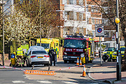 A minor traffic accident, in Nightingale Lane, absorbs the vital time and resources of the emergency services. It was probably cause by impatience at a traffic calming chicane and highlights the knock on risks of not staying at home -  The 'lockdown' continues in Clapham - Coronavirus (Covid 19) outbreak in London.
