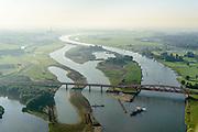 Nederland, Gelderland - Overijssel, Hattem,  28-10-2014; rivier de IJssel bij Hattem met IJsselbrug, spoorbrug bij voor de Hanzelijn (Hanzeboog). Gezien naar het Zuiden met IJsselcentrale (Centrale Harculo). Uiterwaardenvergraving bij Katerveer..<br /> The red railway bridge Hanzeboog (Hanseatic arch) over the IJssel near Zwolle, has been designed by Quist Wintermans Architects. <br /> <br /> luchtfoto (toeslag op standard tarieven);<br /> aerial photo (additional fee required);<br /> copyright foto/photo Siebe Swart