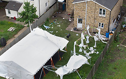 © Licensed to London News Pictures. 24/05/2021. London, UK. A partially damaged marquee stands at a property on Consort Road in Peckham south London near where Black Lives Matter activist Sasha Johnson was shot. Ms Johnson remains in a critical condition in hospital after the shooting which happened at 3am on Sunday morning. Photo credit: Peter Macdiarmid/LNP