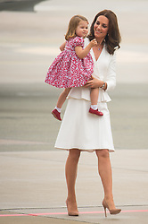 File photo dated 17/07/17 of the Duchess of Cambridge and Princess Charlotte arriving at Warsaw Chopin airport, on day one of their five-day tour of Poland and Germany. Princess Charlotte celebrates her fifth birthday today.