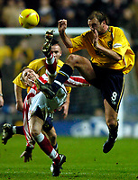 Photo: Richard Lane.<br /> Oxford United v Lincoln City. Nationwide Division Three. 10/01/2004.<br /> Simon Weaver and James Hunt challenge for the ball.