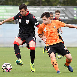 BRISBANE, AUSTRALIA - DECEMBER 10: Alec Maiolo of Adelaide United and Joe Caletti of the Roar compete for the ball during the round 5 Foxtel National Youth League match between the Brisbane Roar and Adelaide United at AJ Kelly Field on December 10, 2016 in Brisbane, Australia. (Photo by Patrick Kearney/Brisbane Roar)