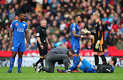 Leicester City's Vicente Iborra (floor) receives treatment for an injury during the Premier League match at the bet365 Stadium, Stoke-on-Trent.