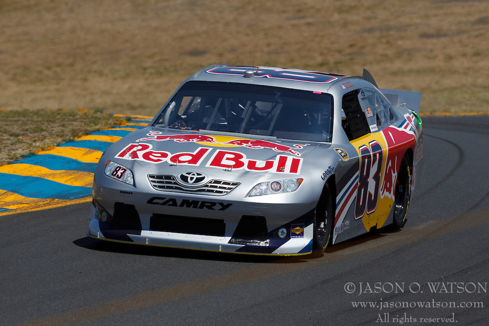 June 24, 2011; Sonoma, CA, USA;  NASCAR Sprint Cup Series driver Brian Vickers (83) drives past turn 2 during practice for the Toyota/Save Mart 350 at Infineon Raceway.