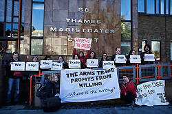 © Licensed to London News Pictures. 03/11/2013. London, United Kingdom. People rally outside the Thames Magistrates Court in support of the 7 people arrested in a mass action on September 8th against the DSEI arms fair. Photo credit : Andrea Baldo/LNP