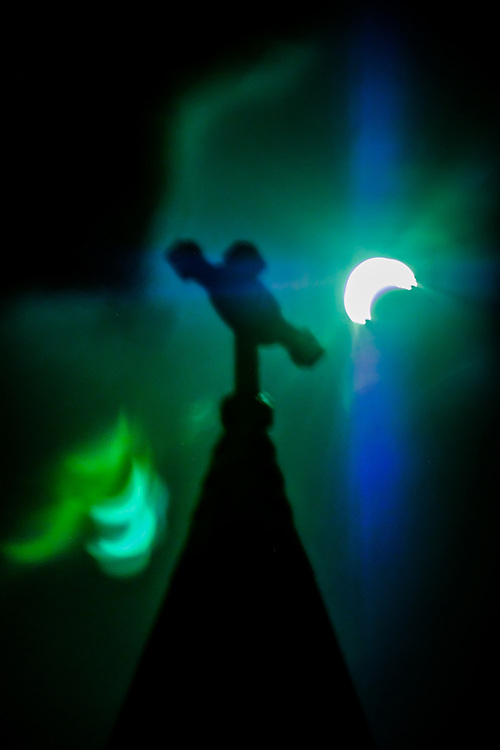 Eclipse over Saint Paul's Church and filter reflections in Ellicott City, Maryland.