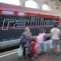 Train passes by illegal migrant family trying to travel to Germany from the main railway station Keleti in Budapest, Hungary on August 31, 2015. ATTILA VOLGYI
