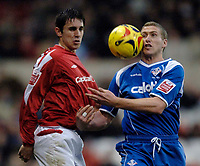Photo: Glyn Thomas.<br />Nottingham Forest v Oldham Athletic. Coca Cola League 1.<br />14/01/2006.<br />Oldham's Chris Killen (R) and Forest's John Thompson both go for the ball.