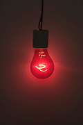 a burning red light bulb
