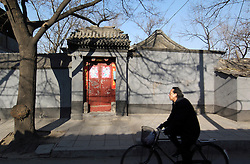 Traditional doorway to an old walled house in an original ancient Beijing hutong
