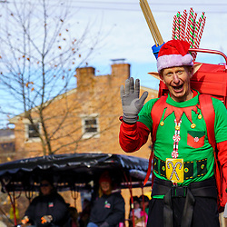 Gettysburg, PA / USA - December 7, 2019:  A happy elf walking in the street at the Gettysburg's Annual Christmas Festival.
