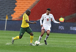 South Africa: Johannesburg: Bafana Bafana player Aubrey Bodiba battle for the ball with Seychelles player Karl Hopprich during the Africa Cup Of Nations qualifiers at FNB stadium, Gauteng.<br />Picture: Itumeleng English/African News Agency (ANA)
