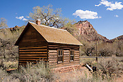 """Capitol Reef National Park, Utah, USA: Built in 1896, the Fruita one-room schoolhouse served as Mormon church & community center and schooled students until 1941. Established in 1880, the Mormon town of Junction became known as Fruita by 1904, also called """"The Eden of Wayne County"""" for its large orchards. Fruita was abandoned in 1955 when the National Park Service purchased the town to be included in Capitol Reef National Park, later restoring the schoolhouse, Gifford house and barn."""