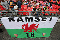 Arsenal's fans unfurl a banner before the match against Chelsea