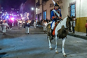 A reenact dressed as Ignacio Allende rides horseback into the city followed by costumed peasant farmers carry torches in a recreation of the Mexican Revolution on the 251st birthday of the Mexican hero January 20, 2020 in San Miguel de Allende, Guanajuato, Mexico.