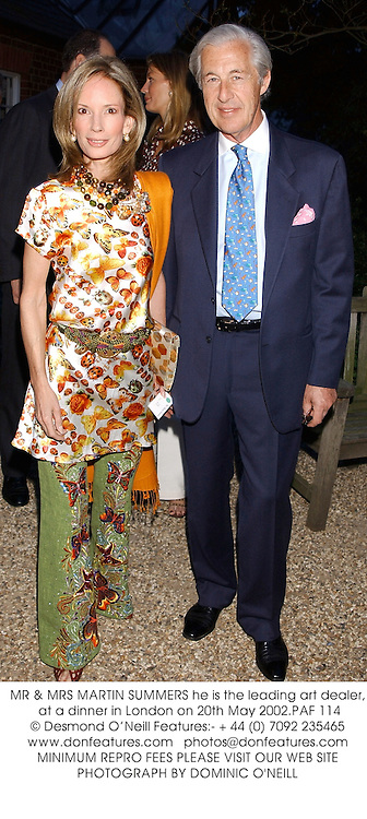 MR & MRS MARTIN SUMMERS he is the leading art dealer, at a dinner in London on 20th May 2002.PAF 114
