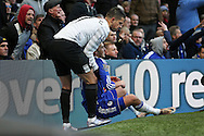 Kevin Mirallas of Everton helps up a smiling Pedro of Chelsea after the Everton player pushed the Chelsea player to the ground. Barclays Premier league match, Chelsea v Everton at Stamford Bridge in London on Saturday 16th January 2016.<br /> pic by John Patrick Fletcher, Andrew Orchard sports photography.