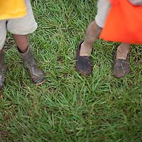 Children arriving at school in Concepción Actelá, Alta Verapaz. If children have footwear in this area it is often rubber boots.