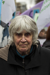 September 10, 2017 - Santiago, Chile - Joan Turner Jara, UK-born former ballet dancer, dance teacher, rights activist and widow of iconic Chilean folksinger Victor Jara who was assassinated during the military dictatorship in 1973, participates in the march towards the General Cemetery...Thousands of people took to the streets on September 11, 2017 in Santiago, Chile, to commemorate the coup d'etat of September 11, 1973, which overthrew President Salvador Allende and established the dictatorship led by General Augusto Pinochet. (Credit Image: © Mauricio Gomez/NurPhoto via ZUMA Press)