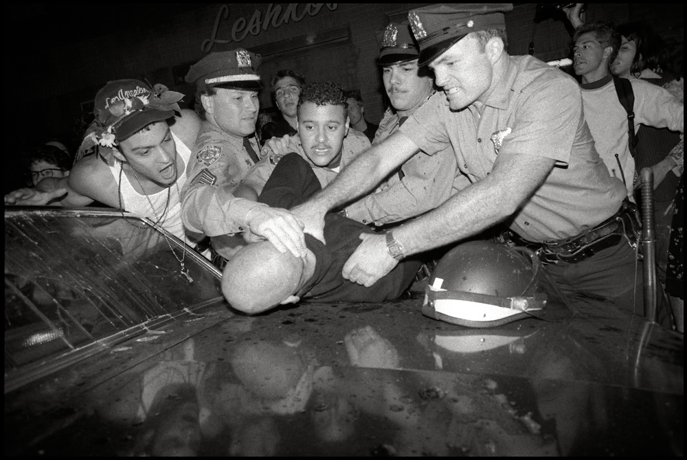 A skinhead is arrested in Tompkins Square Park after throwing a bottle into a crowd at Wigstock, an annual drag festival in New York City, in September of 1989.