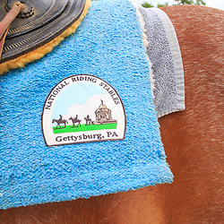 Gettysburg, PA, USA - June 20, 2018: A close up of the National Riding Stable insignia on a horse blanket.