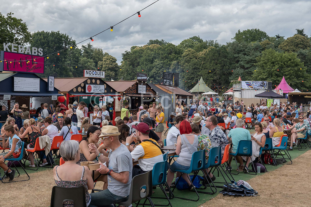 A busy food and drink stalls area during Latitude Festival on the 21st July 2019 in Southwold in the United Kingdom.